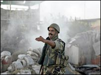 Lebanese soldier beside destroyed anti-aircraft battery in Tyre