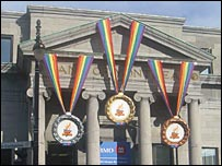 Three medals hanging outside building