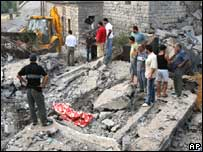 Residents survey the damage of successive Israeli strikes on the Lebanese village of Ansar