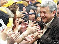 Andres Manuel Lopez Obrador greets supporters on Sunday, 6 August