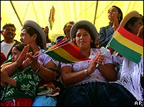 Bolivians wave flags at the inauguration of the assembly