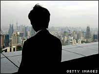A man views skyscrapers in Shanghai, China, May 2006.