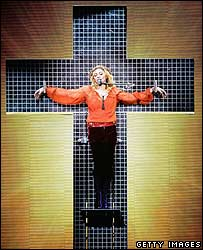 Madonna on a mirrored cross during a performance on the Confessions tour