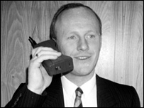 John Caudwell with an early mobile phone