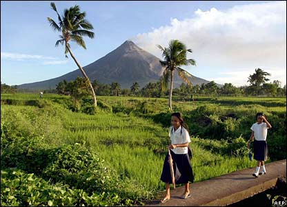 Girls on the way to school in Daraga, near the volcano