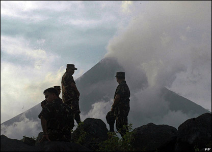 Soldiers keep watch at the foot of the volcano