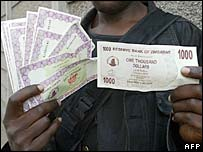 Man holds new Zimbabwean currency