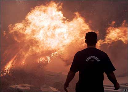 A firefighter looks at a forest fire in Redondela, north-western Spain 6 Aug 06