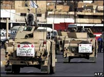 A US military convoy patrols a street in central Baghdad on 7 August