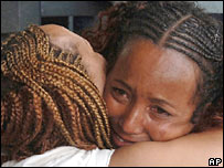 Ethiopian evacuee embraces friend she's leaving behind