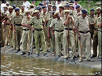 Police by flooded river in Delhi