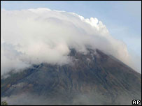 The volcano sends out smoke and ash on 8 August
