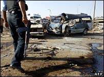 An Iraqi policeman at the site of a roadside bomb in central Baghdad