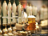 Beer pumps and pint of lager