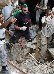 Rescuers dig out a child in Beirut on 8 August 2006 after air strikes late on 7 August