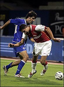 Robin van Persie battles for the ball