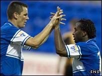 Martin Hardie and Jason Scotland celebrate