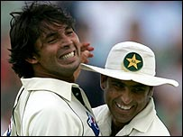 Mohammad Asif celebrates one of his four wickets with Younis Khan