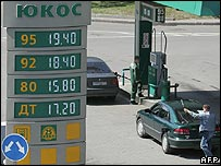 Man filling up car at petrol station owned by Yukos