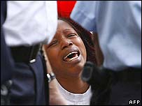 A woman cries during the police operation