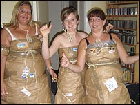 Fans dressed as brown paper packages tied up with string