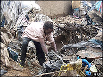 Man digs through mud in Dire Dawa