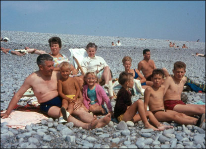 Family sat on beach
