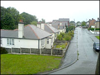 Homes alongside A494 at Aston on Deeside