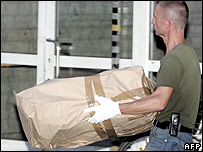 A policeman carries out a suspect package from Dortmund station on 31 July 2006