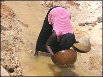 Woman panning for gold in Sierra Leone