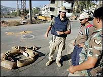 A UK mine clearance expert demonstrates how to dispose of a cluster bomblet safely