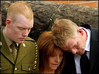 Pte Andrew Cutts' twin brother James, mother Jeannie and father Karl at the funeral (Press Association)