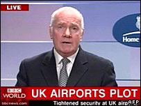 John Reid on TV, announcing details of the alleged terror plot