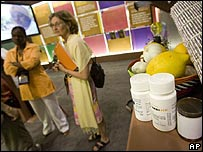 "South African government booth at the 16th World Aids Conference in Toronto displays a mix of anti-retroviral drugs and ""natural therapies"" like lemon and garlic"