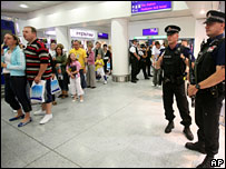 Police watching an airport queue