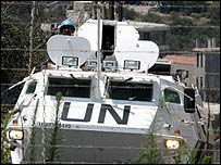 A UN armoured car passes close to Lebanon's border with Israel