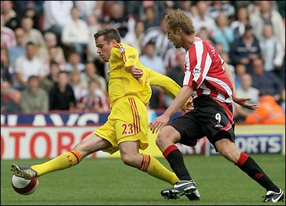 Rob Hulse challenges Liverpool's Jamie Carragher