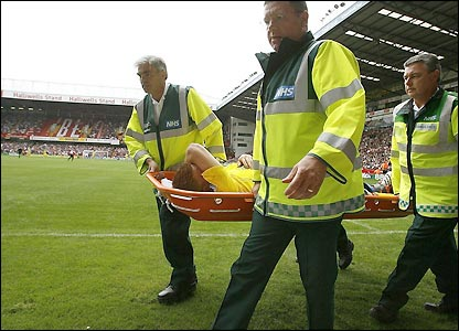 John Arne Riise is stretchered off