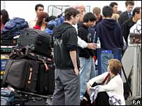 Holidaymakers queue at airport