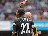 Djimi Traore is sent off by Howard Webb