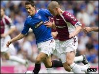 Rangers' Jeremy Clement (left) challenges Calum Elliot