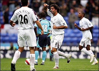 Ivan Campo (centre) celebrates scoring for Bolton