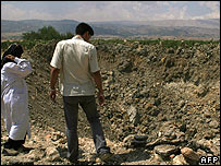 Locals inspect crater after Israeli raid on Bodai