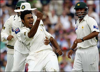 Danish Kaneria celebrates taking the wicket of Andrew Strauss