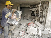 Man with portrait of Hezbollah leader Hassan Nasrallah