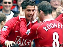Cristiano Ronaldo celebrates with Man Utd team-mate Wayne Rooney