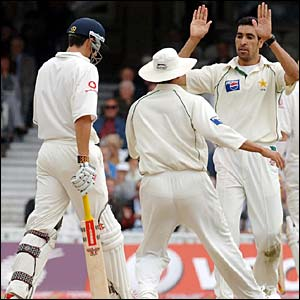 Umar Gul celebrates taking the wicket of Alastair Cook