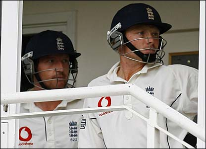 Paul Collingwood and Ian Bell wait patiently to get back out