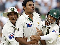 Danish Kaneria, Younis Khan and Faisal Iqbal celebrate Andrew Strauss' dismissal