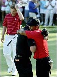 Tiger Woods hugs caddie Steve Williams